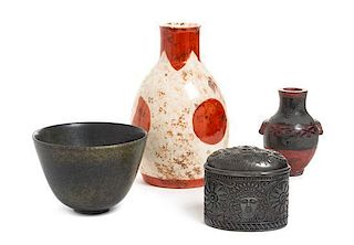 * A Group of Four Japanese Decorative Articles Height of tallest 7 3/4 x width 4 1/2 inches.