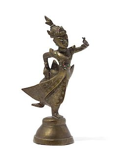 A Bronze Figure of a Deity Height 8 inches.