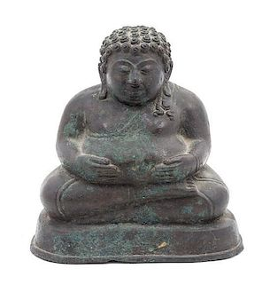 * A Bronze Figure of a Seated Buddha Height 6 1/2 x width 6 inches.