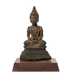 A Gilt Bronze Figure of Buddha Height 9 3/4 inches.
