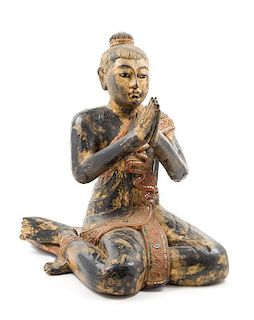 * A Burmese Lacquered Figure of a Seated Monk Height 20 inches.