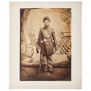 Albumen Photograph Featuring African American Soldier with Benton Barracks Backdrop