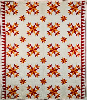 Vintage Star Pattern Patchwork Quilt in Red and Orange Fabrics on White Ground, circa 1920s