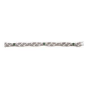 Bracelet with diamonds and emeralds in white 18k gold, with 4 diamonds and 6 emeralds. Weight: 35.8 g. Length: 7.2""