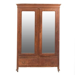 "Wardrobe. 20th century. Carved in wood. 2 hinged doors with rectangular, beveled mirrors, drawer with handles. 79.5 x 53.5 x 22"" (202x136x56cm)"