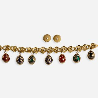 Egg charm bracelet with diamond and gold earrings