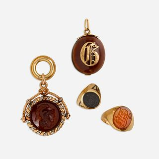 Antique gold watch fob, chestnut charm, and two rings
