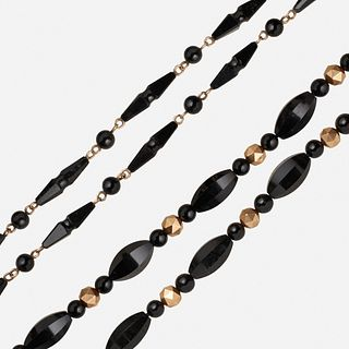 Two Victorian black onyx and gold necklaces