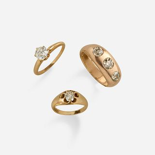 Three diamond and gold rings