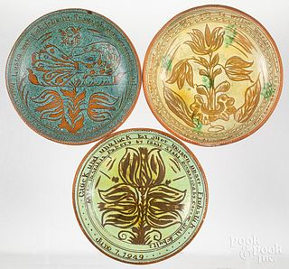 Three Stahl sgraffito decorated redware plates