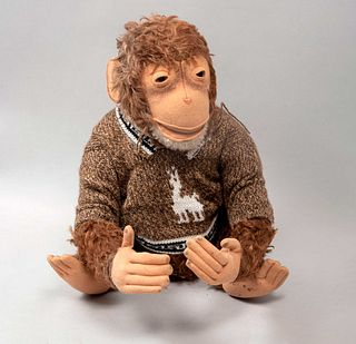 Toy Monkey. Germany. 20th century. Steiff. Plush toy. Dressed with sweater. Brand button.