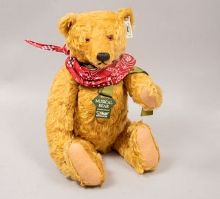 Musical Toy Bear. Germany. 20th century. Steiff. Plush toy. Series number 01644. With button and brand label.
