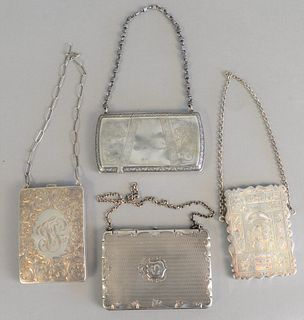 "Four silver purses and card cases having chains, largest ht. 4"", 10 t.oz."