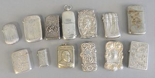 Thirteen silver holders to include 10 match safes with coin holder, 1 with bust of military figure, 3 lighters with cases, etc. 10.5 t.oz.
