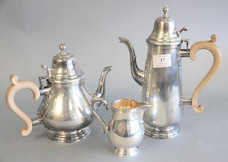 "Three piece English sterling silver tea and coffee set, marked STERLING, ENGLAND on bottom, ht. 11"", 64.3 t.oz."
