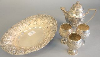"Five Djokja silver pieces to include a teapot, ht. 7"" marked TOM 800, a set of three stemmed cups and a large oval tray marked AD 800, all Indonesian"