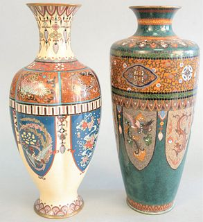 Two Japanese cloisonne vases, one having ribbed body with butterfly, birds of paradise and dragon decoration along with green vase having panels of ph