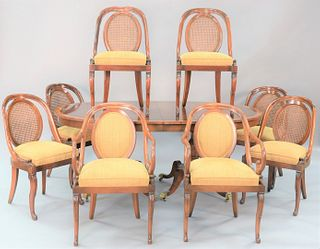 Nine piece mahogany dining room set to include oval banded, inlaid table, 2 arm chairs, 6 side chairs, all with caned back and goosehead supports, ht.