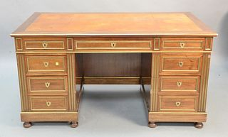 "Louis XVI style mahogany desk having brass mounts and tan tooled leather top, ht. 30"", top 31 1/2"" x 57""."