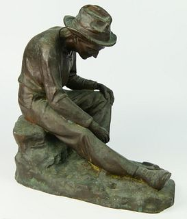LARGE BRONZE SCULPTURE OF SEATED COAL MINER