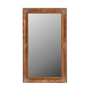 Espejo. SXX. En talla de madera. Con luna rectangular biselada. Decorado con rocalla, veneras, cestería y molduras. 148 x 87 x 5 cm.