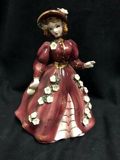 VINTAGE ESD JAPAN FIGURINE OF A PRETTY LADY IN A BURGUNDY DRESS WITH FLOWERS