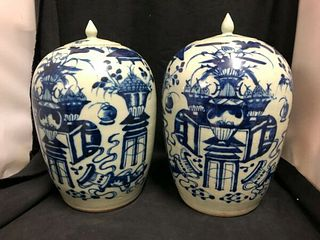 "PAIR OF CHINESE BLUE AND WHITE COVERED URNS  15""H X 9""W"