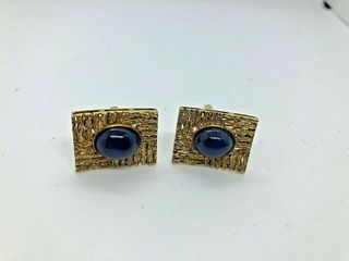 Pair Of 14K Yellow Gold Cufflinks with Synthetic star sapphires