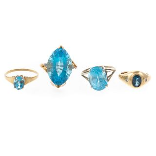 A Collection of Blue Topaz Rings in Gold