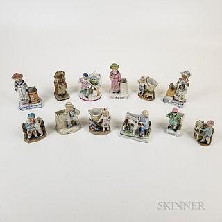 Twelve Figural Porcelain Match Strikes