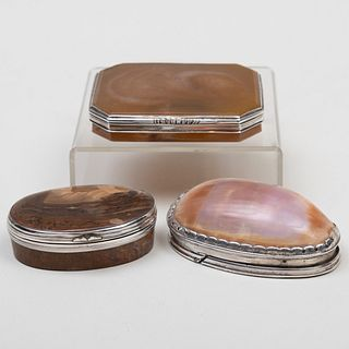 Two Continental Silver-Mounted Hardstone Snuff Boxes and a Silver-Mounted Shell Snuff Box
