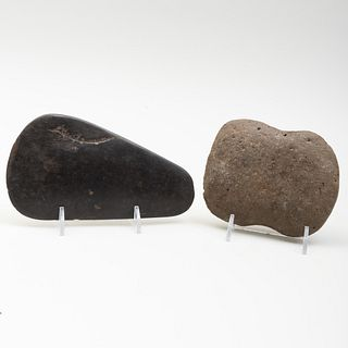 Two Neolithic Carved Stone Axe Heads