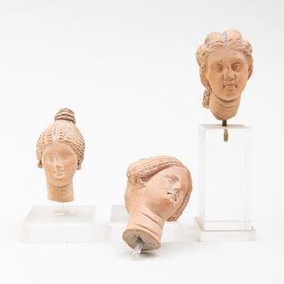 Group of Three Greek Terracotta Heads of Women
