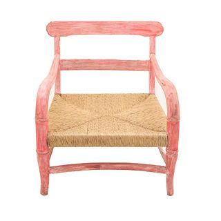 Armchair. 20th century. Carved in wood. Bamboo design in lacquered pink, woven palm seat.