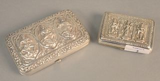 Two Indonesian silver cigarette boxes with figures, one inscribed 'Lt. Colonel George Wilson DSO The King's own Royal Regiment', 8.5 t.oz.