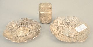 """Three-piece reticulated silver lot to include two Chinese saucers, dia. 5 1/2"""" along with a container, 3 1/4"""" with a lid, 8.7 t.oz. ."""