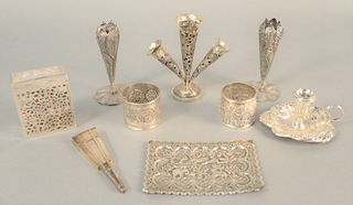 Nine-piece silver lot to include vases, candleholder, cigarette box, two napkin rings, silver fan box, 15.1 t.oz. .