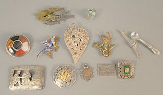 Ten silver pins, two with enamelling, one with gold mounts, one mounted with stones, two medallions, 4.5 t.oz. .