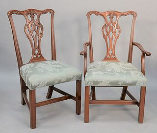 Set of twelve Chippendale-style dining chairs to include ten side and two arm.