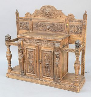 """Continental heavily carved hall table/cane holder, having two doors, Ht: 52"""", Wd: 56."""