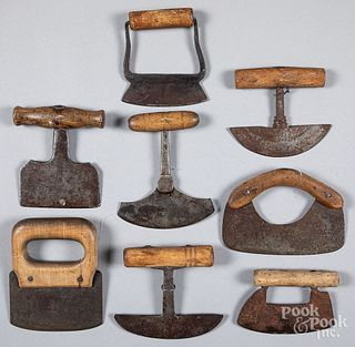 Eight early wood and iron food choppers.