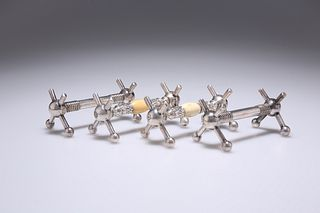 TWO PAIRS OF 19TH CENTURY SILVER-PLATED KNIFE RESTS, one pair with ivory mo
