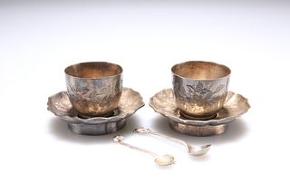 A PAIR OF CHINESE EXPORT SILVER CUPS AND SAUCERS, with associated spoons, e