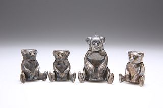 FOUR CHINESE WHITE METAL NOVELTY PEPPER POTS, each in the form of a teddy b