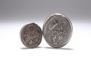TWO CHINESE SILVER BOXES, oval, the first with hinged cover chased with a b