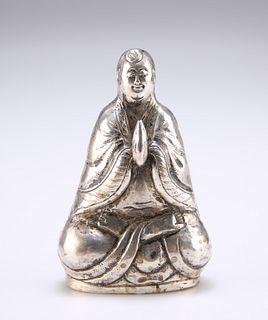 A CHINESE SILVER BUDDHA PEPPER POT,?with hands in anjali mudra, stamped SIL