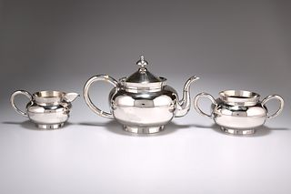 A CHINESE SILVER THREE PIECE TEA SERVICE, by Wang Hing & Co, late 19th/earl