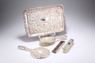 A DRESSING TABLE SET, comprising a silver-backed mirror, silver-mounted com