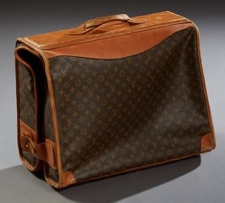 Louis Vuitton Hanging Folding Garment Bag, with leather trim, the interior with original paper label, H.- Closed- 21 in., Open- 42 i...