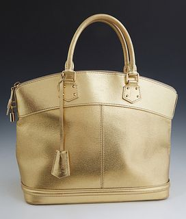 Louis Vuitton Gold Suhali Leather Lockit MM Bag, with gold tone hardware, the zipper opening to a gold jacquard lining with three in...
